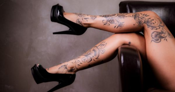 flower tattoo, leg tattoo, pinup tattoo idea for legs of pinup