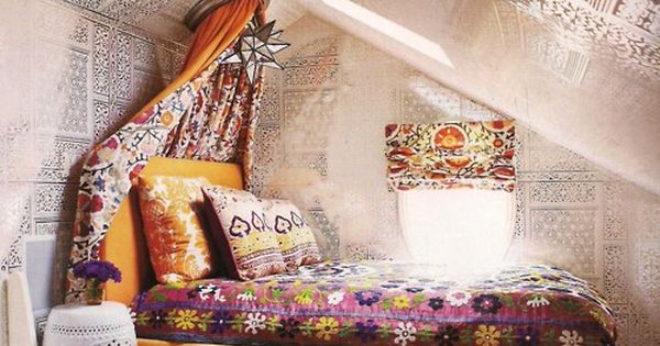 Beautifully decorated attic space. Love the big floor pillows in a different