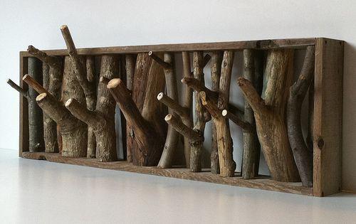 wood coat hooks... a little rustic, but I like the idea
