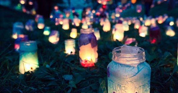 mason jar lanterns covered with tissue paper and either break and pour
