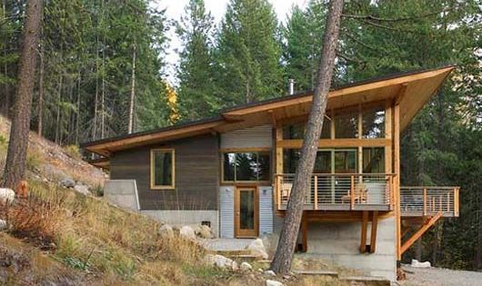A 1 500 Square Foot Cabin Built Into A Step Hillside Overlooking A Stream With A View To The Mountains In The Distan Cabin Design Modern Cabin Building A House