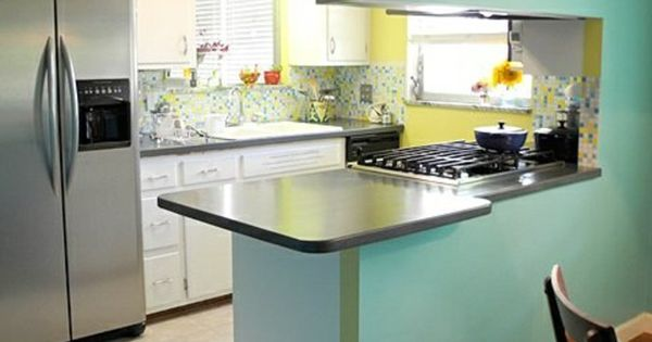 La cuisine americaine murs bleus ciel sol en parquet fonc for Decoration interieure cuisine americaine