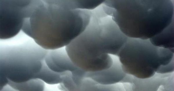 Some pretty awesome mammatus clouds looming, and likely associated with a cumulonimbus