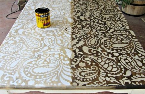 DIY furniture redo - wood stain over painted stencil - http://www.domesticimperfection.com/2012/05/paisley-stenciled-table/