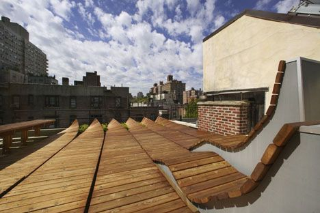 Roll Up Rooftop Daring Rounded Wood Deck Design In Nyc Roof Garden Rooftop Design Wood Deck Designs