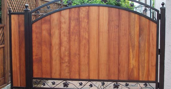 Wooden Gates With Black Metal Frame Iron Grape Vine