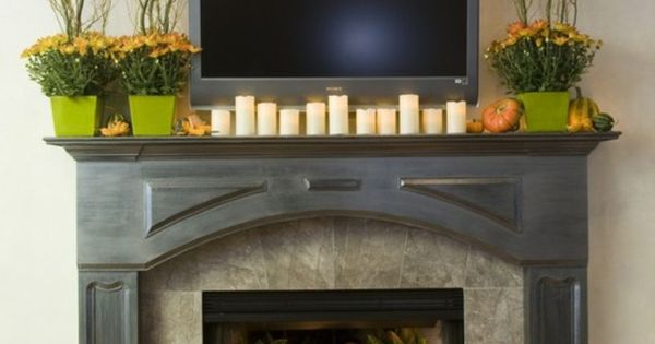 fall mantle and fireplace... love pumpkins in fireplace