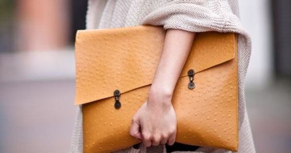 Loose Jumper and Oversized Clutch Bag
