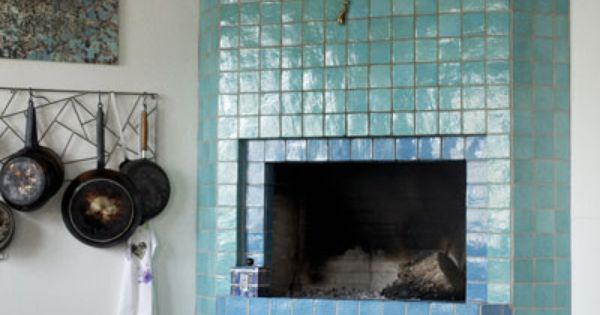 Love this blue tiled fireplace in the kitchen - so cosy