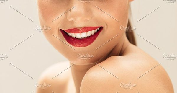 Close up portrait of happy woman with beautiful skin. Pretty female model with natural makeup.