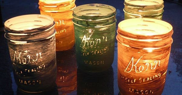 Painted Mason jars used for pretty votive candle holders