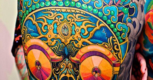 Bright colored skull back tattoo design