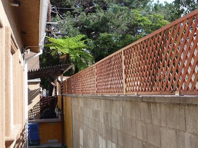 Privacy Trellis Added To Cinder Block Wall Cinder Block Walls Concrete Block Walls Privacy Trellis