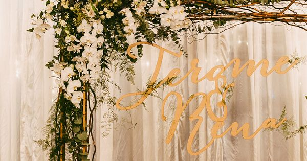 Wedding Arch With Florals And Laser Cut Sign With The