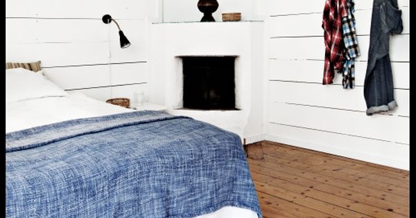 white bedroom & corner fireplace.