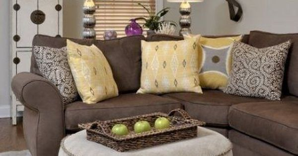 brown sofa and griege walls. but in our accent colors instead