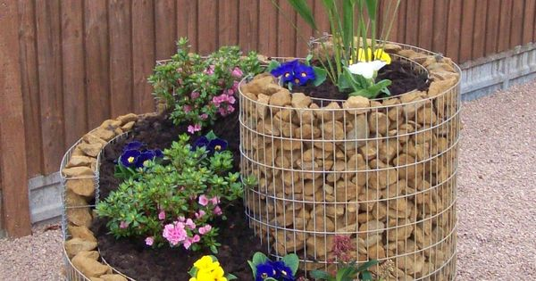 DIY spiral garden with chicken wire and rocks