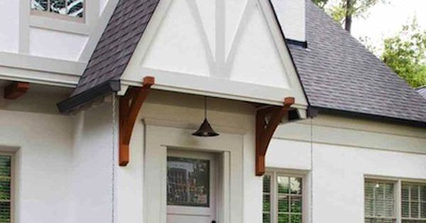 Tudor Style Home Remodel With Wood Brackets Rain Chain