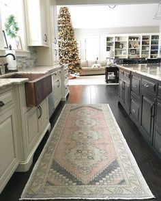 Neutral Kitchen With Copper Farmhouse Sink And Vintage Oushak Rug Two Toned Kitchen Open Farmhouse Kitchen Decor Modern Kitchen Rugs Farmhouse Style Kitchen