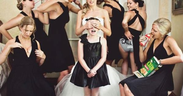 Funny bridesmaids picture with the bride and flower girl.