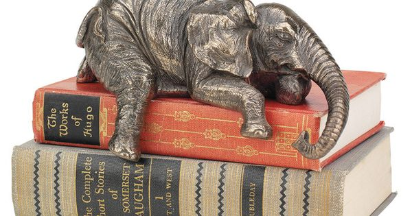 Artfully hand-finished, this charming elephant statuette adds a whimsical touch to stacked