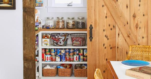 Gorgeous pantry with sliding barn door built from reclaimed pine. Love the