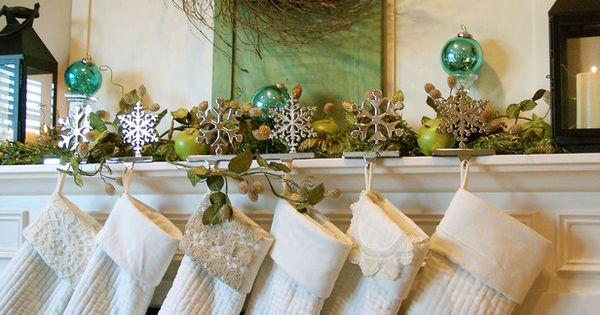 Green and blue Christmas mantel with white stockings