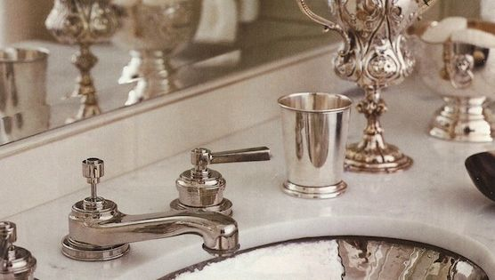 Carrera Marble Vanity With A Hammered Silver Sink Silver Faucet And Accessories Trophy With