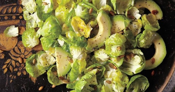 brussels sprouts and avocado salad with roasted pumpkin seeds