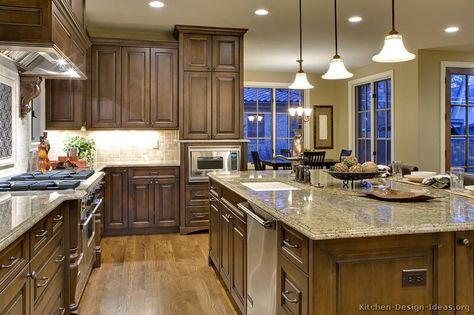 Kitchen Of The Day A Lovely Kitchen With Rich Chocolate Stained Cabinets Hardwood Flo Traditional Kitchen Cabinets Kitchen Design Traditional Kitchen Design