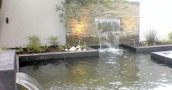Classic letterbox spout sheets of water the waterfall for Formal koi pond
