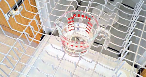 Clean Dishwasher: Place a dishwasher-safe cup filled with plain white vinegar on