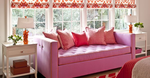 Patterned window treatments. Pink and orange living room.