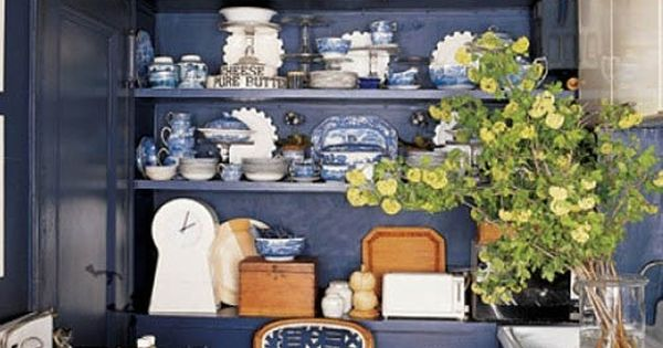 Blue Kitchen, blueware in built in shelves. Small kitchen boldly done. Elle