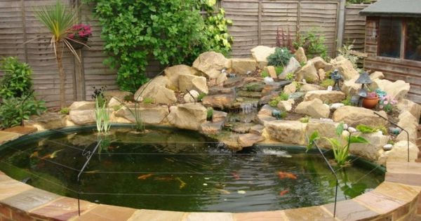 Raised pond ponds and water pond on pinterest for Stone koi pond