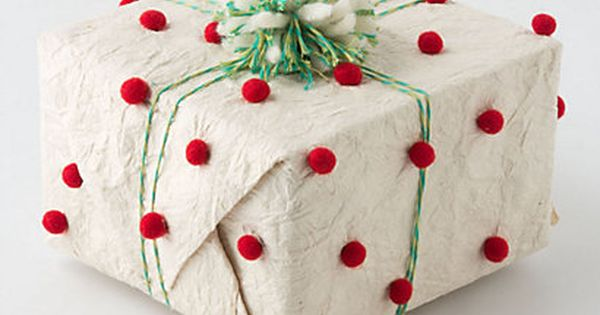 pompom wrapping paper. Fun gift wrapping idea.