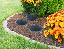 Planting Nursery Pots In Your Flower Bed Instead Start With Plastic Nursery Style Pots Make Sure They Have Drainag Plants Container Gardening Planting Pots