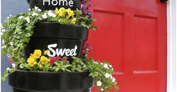 Love the black planters and I love the red door, we should