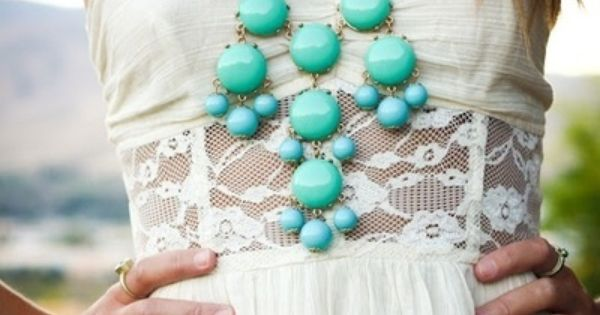 white lace dress and turquoise bubble necklace