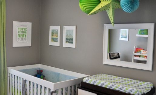 Check out our colorful brown baby room. Get more decorating ideas at