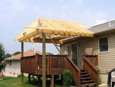 How To Build A Roof Over A Deck Ehow Building A Pergola Building Roof Pergola
