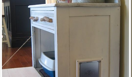 An old dresser made into a cat litter box storage area....the front