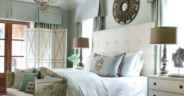 Boarded vaulted ceiling, chandelier, distressed furniture, tufted headboard, light blue and cream