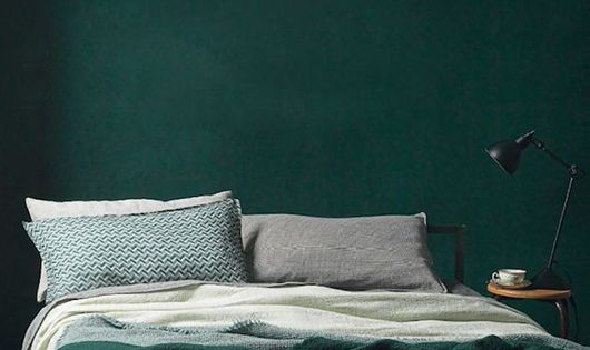 Dark Green Bedroom Wall With Bedding In Shades Of Green