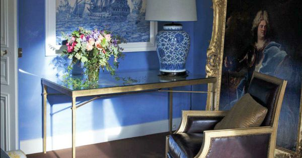 Regency style living room with cornflower blue walls and chocolate