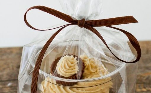 Need to package individual Cupcakes? Put them in a clear plastic cup, put the cup in a bag, tie with a ribbon and voila! (Peanut Butter Ball Chocolate Cupcakes With Peanut Butter Buttercream Recipe)