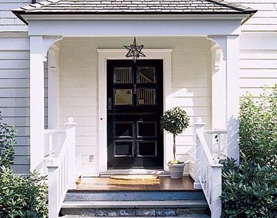 Front Porch Ideas... NOTE love the way rail comes in off of