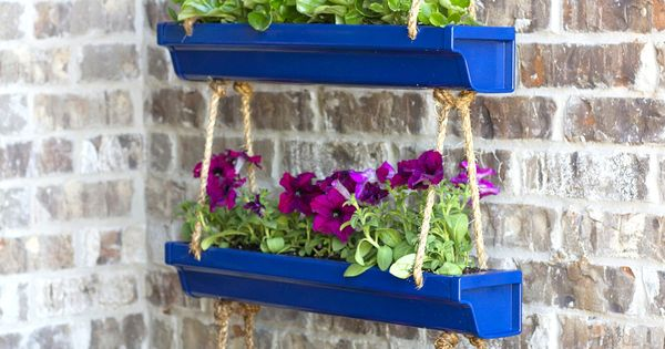 Diy hanging rain gutter planters via make it and love it for Rain gutter planter box