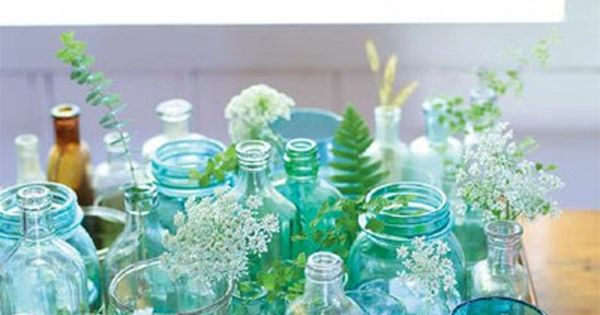 What a brilliant idea and how beautiful - mixed glasses, bottles, jars