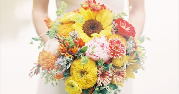 Orange and Yellow Wedding Bouquet created by the famous Cedarwood Weddings.